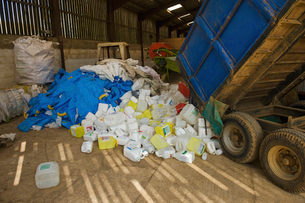 A heap of plastic recycling, waste piled up beside a trailer.の写真素材 [FYI02252508]