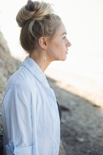 Profile portrait of a blond woman with a hair bun.の写真素材 [FYI02252534]
