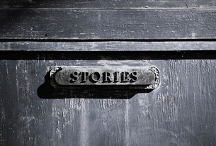 Stories plaque on a flat surface, a filing cabinet or drawer.の写真素材 [FYI02252649]