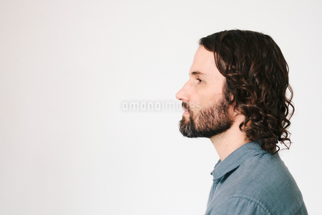 Head and shoulders of a young man with a beard.の写真素材 [FYI02252660]