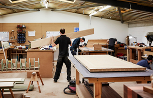 A furniture workshop making bespoke contemporary furniture pieces using traditional skills. Two menの写真素材 [FYI02252744]