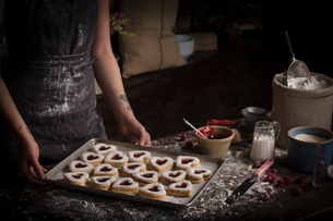 Valentine's Day baking, high angle view of a baking tray with heart shaped biscuits.の写真素材 [FYI02252857]