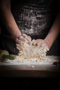 Valentine's Day baking, woman preparing dough for biscuits.の写真素材 [FYI02252863]
