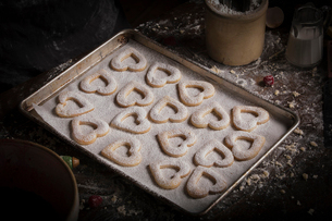 Valentine's Day baking, high angle view of a baking tray with heart shaped biscuits.の写真素材 [FYI02252948]