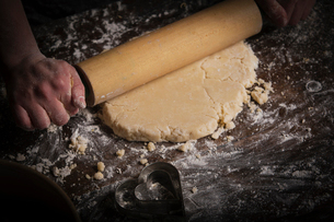 Valentine's Day baking, woman rolling out dough with a rolling pin.の写真素材 [FYI02252964]