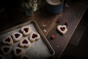 Valentine's Day baking, high angle view of a baking tray with heart shaped biscuits.の写真素材 [FYI02253004]