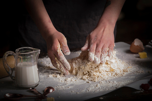 Valentine's Day baking, woman preparing dough for biscuits.の写真素材 [FYI02253145]