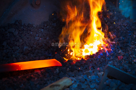 A length of red hot metal in a furnace.の写真素材 [FYI02253153]