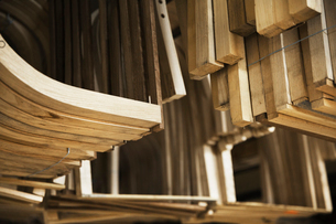 Close up of wooden furniture pieces in a carpentry workshop.の写真素材 [FYI02253409]