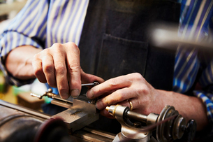 A clock maker busy in his workshop.の写真素材 [FYI02253500]