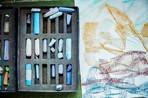 An artist's canvas with an artwork in progress, and box of pastels, colours.の写真素材 [FYI02253551]