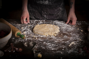 Valentine's Day baking, woman preparing dough for biscuits.の写真素材 [FYI02253692]