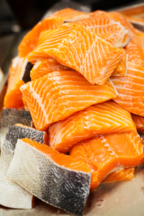 Close up of a stack of salmon fillets.の写真素材 [FYI02253771]