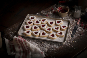 Valentine's Day baking, high angle view of a baking tray with heart shaped biscuits.の写真素材 [FYI02253922]