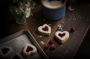 Valentine's Day baking, high angle view of a baking tray with heart shaped biscuits.の写真素材 [FYI02254373]