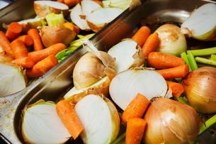 Close up of a selection of fresh vegetables, including carrots and onions.の写真素材 [FYI02254607]