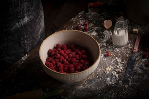 Valentine's Day baking. A high angle view of a bowl of fresh raspberries.の写真素材 [FYI02254791]