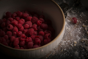 Valentine's Day baking.  High angle view of a bowl of fresh raspberries.の写真素材 [FYI02254835]