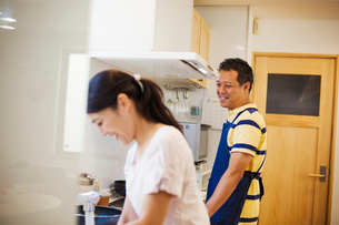 Family home. A man and woman, husband and wife together at home.の写真素材 [FYI02255382]