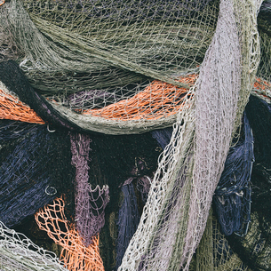 Close up of a pile of tangled up commercial fishing nets.の写真素材 [FYI02255520]