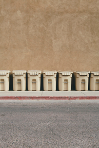 Row of recycling containers along sidewalk and streetの写真素材 [FYI02255544]
