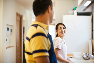 Family home. A man and woman, husband and wife together at home.の写真素材 [FYI02255587]