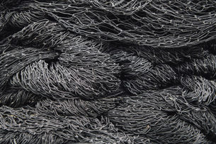 Close up of a pile of tangled up commercial fishing nets.の写真素材 [FYI02255711]