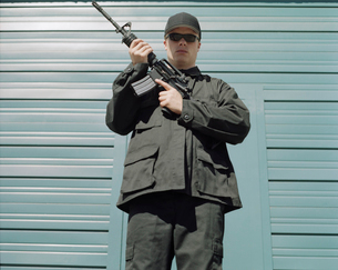 Man wearing special forces uniform and holding high powered semi-automatic rifleの写真素材 [FYI02255773]