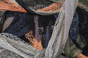 Close up of a pile of tangled up commercial fishing nets.の写真素材 [FYI02255951]