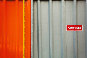 A fence of corrugated iron, a construction site boundary. Safety notices.の写真素材 [FYI02255976]