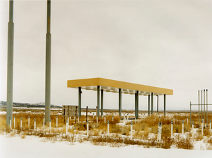 An abandoned gas station, petrol station in the middle of nowhere, plants growing over the forecourtの写真素材 [FYI02256141]