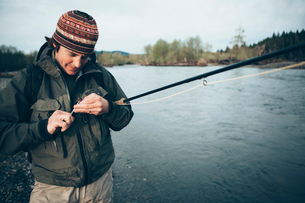 Middle aged man fly fishing on the Hoh River, Olympic National Park, Washington.の写真素材 [FYI02256228]