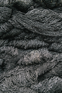 Close up of a pile of tangled up commercial fishing nets.の写真素材 [FYI02256282]