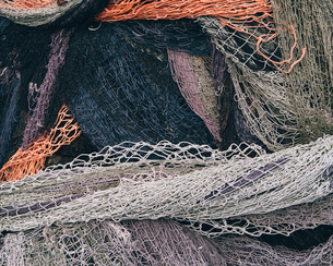 Close up of a pile of tangled up commercial fishing nets.の写真素材 [FYI02256416]