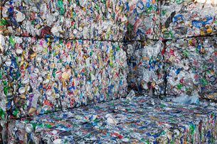 Compressed bundles of plastic bottles at a recycling centre.の写真素材 [FYI02256468]