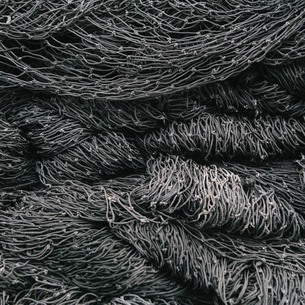 Close up of a pile of tangled up commercial fishing nets.の写真素材 [FYI02256565]