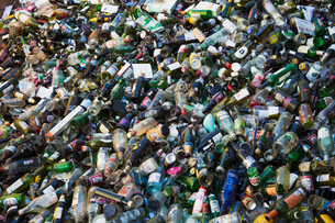 Heap of recycled bottles at a recycling centre.の写真素材 [FYI02256796]