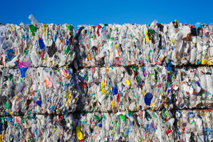 Compressed bundles of plastic bottles at a recycling centre.の写真素材 [FYI02256817]
