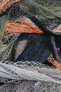 Close up of a pile of tangled up commercial fishing nets.の写真素材 [FYI02256837]