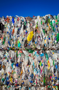 Compressed bundles of plastic bottles at a recycling centre.の写真素材 [FYI02257116]