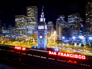 View from the air of the Ferry Building in San Francisco, at night. The city buildings of downtown aの写真素材 [FYI02257155]
