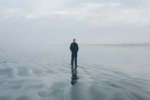 Middle aged man standing on a beach at Seabrook, Washington, USA.の写真素材 [FYI02257170]
