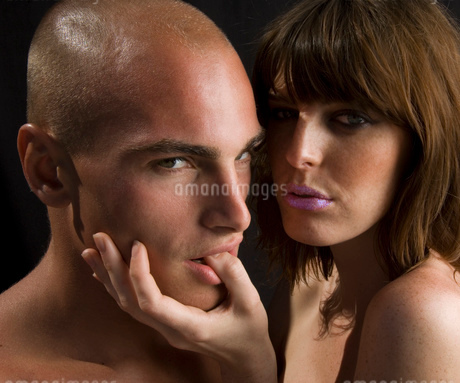 Nude couple, man sucking woman's thumb.の写真素材 [FYI02257403]