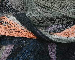 Close up of a pile of tangled up commercial fishing nets.の写真素材 [FYI02257405]