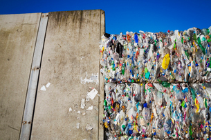 Compressed bundles of plastic bottles at a recycling centre.の写真素材 [FYI02257489]
