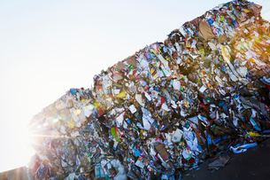 Compressed bundles of plastic bottles at a recycling centre.の写真素材 [FYI02257507]