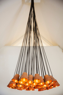 Close up of contemporary chandelier made out of terracotta flowerpots in a hotel.の写真素材 [FYI02257533]