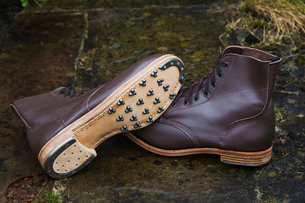 Pair of brown leather work boots with studded sole, hobnail boots and heel from a shoemaker's workshの写真素材 [FYI02257688]