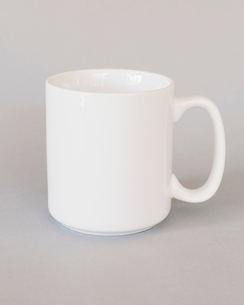 A white porcelain mug against a grey background.の写真素材 [FYI02258206]