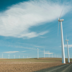 Wind turbines, tall white towers in the flat plains by a road near the Columbia River Gorge.の写真素材 [FYI02258242]